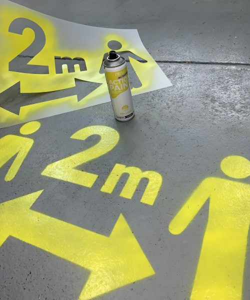 stencilling social distance markers on floor 2m apart