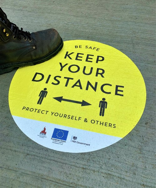Keep your distance protect yourself floor sticker for local council