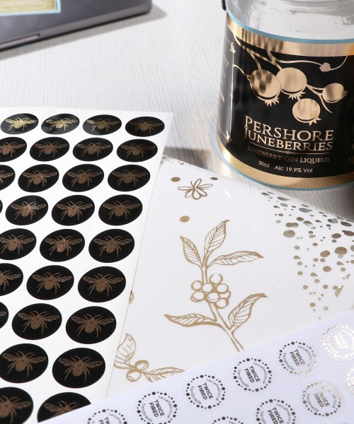Black and gold foil stickers, transparent gold stickers & metallic gold stickers on a roll